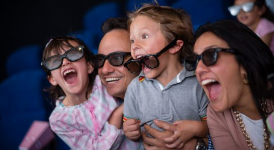 Family at the movie theatre enjoying a 4D experience